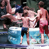 11-year-old Lindsay West of White Oak takes a dive into a pool set on a trampoline while friends wait their turn.  Lester Phipps, Jr.