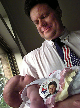 Daryl Atkinson's 6 week-old daughter Marilyn Blair will have to wait until the next election before she can join her father at the Democratic Nominating Convention, but if she could, she'd go with Clinton all the same. Atkinson left for Chicago on Sunday. Chris Matula photo.