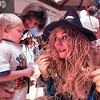 "Scarecrow Tina Bush tries to get 3-year-old Ryan Gillam to feel her ""hair"" following her performance with other Junior League members at the Reading Rally at Longview Mall Friday.  Lester Phipps, Jr."