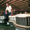 Jack Willis stands between his two favorite T-birds in his home garage in Daingerfield.  Lester Phipps, Jr.