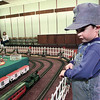 "4-year-old Nathan O'Quinn, dressed for the part, spends his morning at the Gregg County Historical Museum train exhibit.  ""This is the second time he's come here"", said his mother Sharon.  ""I figured with the weather turning for the worse I'd best get him out of the house for a while.""  Lester Phipps, Jr."