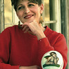 Peggy Sue Caston with a Michelangelo angel egg she painted. Chris Matula photo.
