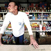 John Moore waits patiently for customers at a fireworks stand two miles east of Loop 281 on Hwy 80 Saturday afternoon. Business was slow for the holiday season with only four customers coming in all day. Matula photo