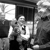 """David Compton with Longview Cmty Theater laughs as Janna Robbins plays with her new """"Tickle Me Elmo"""" doll bought by her husband, John (background), at auction for $575. The money goes to the theater. Matula photo."""