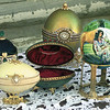 Some of the eggs Peggy Sue Caston has done in the Faberge design and the first egg she ever painted of a squaw and horse, at right, Chris Matula photo