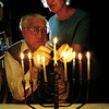Coen and Jannie Rood, Dutch-Jewish immagrants living in White Oak, light their menorah for the Hanukkah celebration. A candle is lighted for each of the eight-day ritual which begins at sunset Thursday. Chris Matula photo.