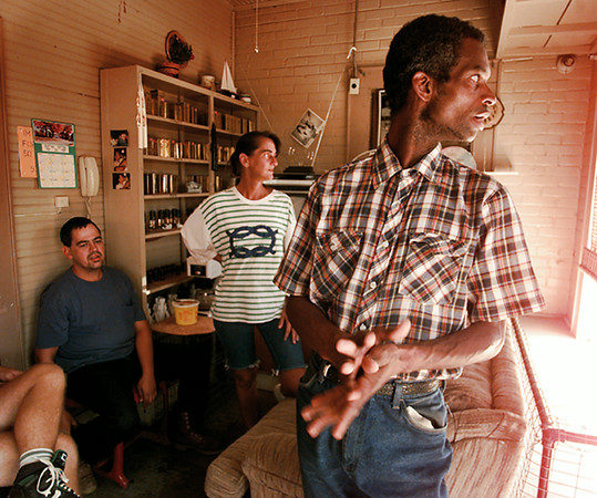Pecan Hill Ranch's Rita Bray looks out the window of the S&S Key with two of her residents Kevin Moore, left, and Fred Cooper Wednesday afternoon. Bray brings hope to the homeless in Marshall by giving them freedom and self-respect. Chris Matula photo.