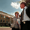 Gov. George Bush chats with Jefferson ISD superintendent Carol Harrell Tuesday afternoon across from the Marion County Courthouse about future renovation plans for the Jefferson downtown area. Chris Matula photo.
