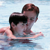 4-year-old Garrett DiPasquale gets lessons on holding his breath underwater from PALS swimming instructor Jason Young at the Longview Swim Center Monday.   Lester Phipps, Jr.