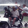 These two golfers were nice enough to bring in stranded equipment and two tournament helpers as they scramble to get out of a driving rain that disrupted the Alpine Pro-Am Monday afternoon. Chris Matula photo.