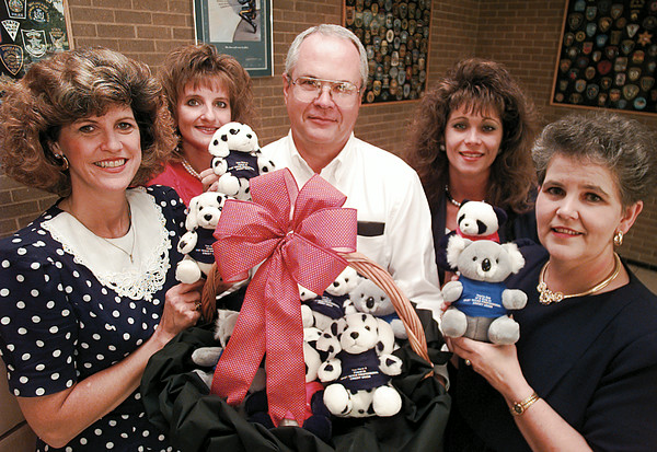 Employees of the East Texas Professional Credit Union donates teddy bears to the LVPD for giving to youngsters involved in domestic disputes and accidents. (l-r) Susan Bradley, Janice Screws, LVPD Chief Johnny Upton, Kathy Deaton and Carolyn Dean. Chris Matula photo.
