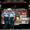 Tommy Daniel and his father David talk shop at the central LV fire station Wednesday. A new law allows relations to work on the same city fire departments as long as it is not on the same shift. Chris Matula photo.