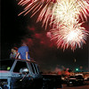 Steve and Leandra Armstrong with 2-1/2-year-old Robert and 5-year-old Kayla Cole sit atop their pick-up to watch the  Heartland Celebration Fireworks at the Gregg Co fairgrounds Thursday night.  Thousands of watchers gathered at the covention center and fairgrounds in additon to Cotton St. and Marshall Ave. to view the event.  Lester Phipps, Jr.