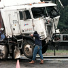 One of four wrecked tractor trailers is loaded onto a wrecker near Gladewater Wednesday.  Chris Matula