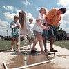 Mary Clark, 11, gets help from volunteer Eddie Berumen, right, in launching her water rocket. Students at LeTourneau's Space Camp got to build rockets, learn about outer space and discover a little about hydrodynamics. Chris Matula photo.