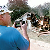 John Mason Of Corsiccana Films the Demolition of a drug house on Bates Street in Kligore Saturday afternoon. By Kevin
