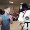 7-year-old Blane Allison gets a lesson from Karate black belt Shae McFadden on how to get loose if someone grabs your arm.    McFadden and Kathy Buroker read to students and demonstrated some self-defense techniques at G.K. Foster Primary School to kick off the summer school library program.      Lester Phipps, Jr.