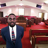 Pastor Tim Brown stands inside the newly rennovated sanctuary at Golden Hill Missionary Baptist Church.   Lester Phipps, Jr.