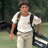 Christian Sarran approaches the 18th green at Oak Forest Monday during the NTPGA Junior tourney. Chris Matula photo.