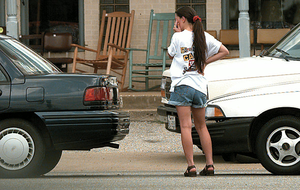 Tawnya Kuykendall, 17, is a bit of a nervous wreck Thursday afternoon after accidentally rear-ending Susan Ridge (NP) in the 3800 block of Marshall. No one was hurt, but it took Tawnya a while to calm down. Chris Matula photo.