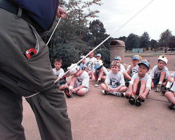 Neal Ranne shows a group of cub scouts the basics of knot tying.   Lester Phipps, Jr.