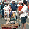 "Eric Harper gives his pup ""Boomer"" the day off by hauling him around the Baloon Race Friday evening in a wagon-along with all the freebies he received from vendors. Chris Matula photo."