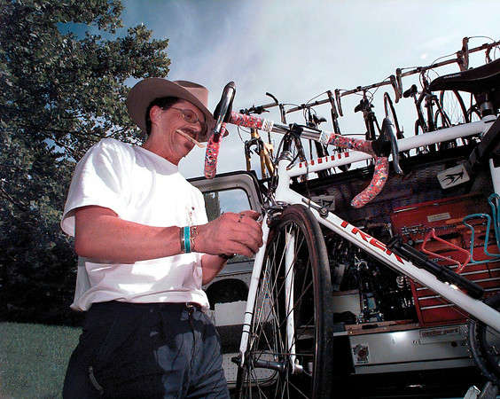 Alan Enslow with Wrench Force Technical Support repairs a bicycle on site at Longview High School.  Enslow travels with his repair van complete with spare bicycles, around the country with various touring groups.   Lester Phipps, Jr.