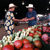 Mary Johnson buys some tomatoes from Tracy Lemons of Brownsboro.   Lester Phipps, Jr.