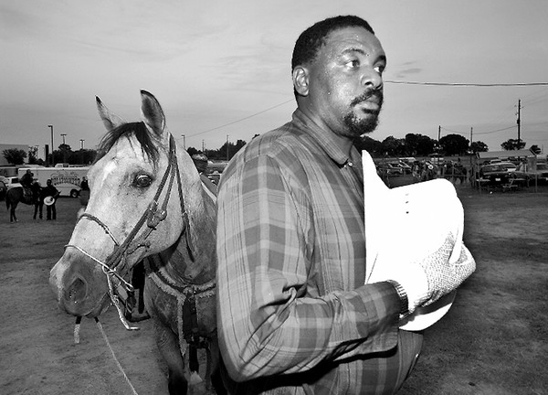 Cowboy Jimmy Johnson from Overton removes his hat for the playing of the Star Spangled Banner before the start of the Juneteenth Rodeo at the LV fairgrounds Saturday evening. Chris Matula photo.