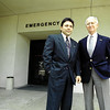 Former Gilmer Medical Center Administrator Al Chapa and board Chairman Gordon L. Bowers outside the emergency entrance the day the hospital announced it would close it's doors effective Sept. 30, 1995. (file photo taken 8-28-95 by Lester Phipps, Jr.)