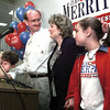 Republican Congressional candidate Ed Merritt of Longview, flanked by his son Jacob, wife Suzanne and daughter Jessica, speaks to supporters at his election night headquarters at Maude Cobb Convention and Activities Center Tuesday night.  Lester Phipps, Jr.
