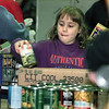 Lucy Roll. 8. lends a hand sorting food at Maude Cobb Center Tuesday. Chris Matula photo.
