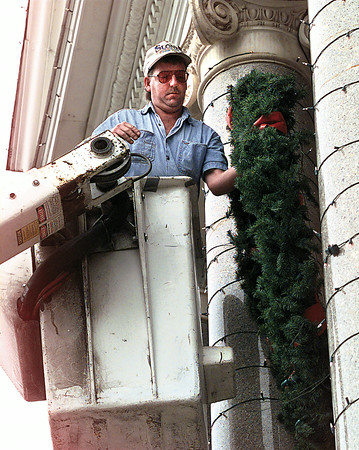 Larry Cain with A & H Electric of Marshall puts the finishing touches on the Old Courthouse Museum in downtown Marshall in preparation for the Marshall Wonderland of Lights, which is scheduled to be officially opened next Wednesday evening.  Lester Phipps, Jr.