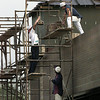 Workers haul bricks up to the roof of the new strip center across from Carmike Theater Thursday. Chris Matula photo.