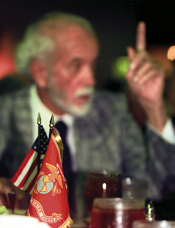 Max Frentrup, former Marine Corporal, talks over old times with war buddies at a reunion of the 2nd Marine Division Saturday night at the Holiday Inn in Longview. Frentrup was a veteran of the campaigns on Tarawa, Saipan, Tinian, Okinawa and the occupation of Japan during WWII. Chris Matula photo.