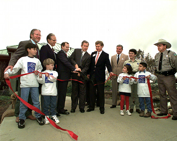 Texas Governor George W. Bush cuts the ribbon on the new Texas Freshwater Fisheries Center in Athens Tuesday.  Lester Phipps, Jr.