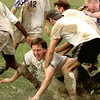 John Connerly assistant coach for the Western Baptist College  gets thrown in the mud following their Championship game where they defeated Pacific Christian six to two Saturday afternoon at LeTourneau Unversity during the NCCAA soccer Tournament. by Kevin Green