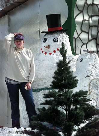 Theresa Arnold doesn't know where to turn next while helping her dad Troy build the exhibits for the Laneville light park Wednesday afternoon. She is trying to finish up the North Pole area by decorating the Mr. and Mrs. Jack Frost. Chris Matula photo.