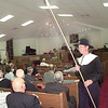 Bill Shirley of Longview represents a Tithing Man during the Colonial style church service Sunday morning at Holy Trinity Church of Christ. The tithing men as they were called would walk around during the service and wake people up if they had fallen asleep. By Kevin Green