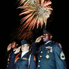 Longview Station recruiting commander Sgt. 1 Class Kevin Brown joins LHS Junior ROTC cadets Sarah Simpson and Eric Williams in a salute during the Honor America clebration fireworks display at Lobo Stadium Saturday night. Chris Matula photo.