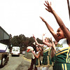 Longview High School cheerleaders and the Lobo mascot give the Lobo football team a rousing send-off Friday morning as the team heads for Bedford for the District playoff game scheduled for Saturday at Pennington field.  Lester Phipps, Jr.