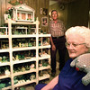 Maxine Campbell sits with just a small portion of her frog collection. Husband Herndon is in the background. Chris Matula photo.
