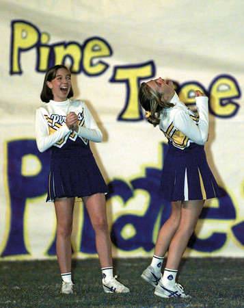 PT cheerleaders Renee Silverthorne, left, and Holly Turner , both 15, have a big laugh as they await the arrival of the football team before their mathup against Kilgore Friday evening. Chris Matula photo.