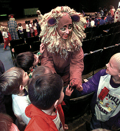 "Melanie Murphy as the ""Cowardly Lion"" visits with Hallsville Primary School kindergarteners following the presentation of the Junior League of Longview production of ""Dorothy Meets Alice"" at T.G. Field auditorium Tuesday morning.  The play will be presented throughout the week to schools from across the area.  Lester Phipps, Jr."