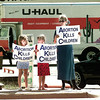 CASSIE WALTERS SEVEN YRS. OLD OF LONGVIEW STANDS WITH HER BEST FRIEND LAUREN AND HER MOTHER JANET BOURCIER BOTH OF LONGVIEW ALONG EAST MARSHALL SUNDAY AFTERNOON. BY KEVIN GREEN