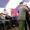 Texas Agriculture Commissioner Rick Perry gives Lonnie (Bo) Pilgrim a hug after addressing attendees at the Golden Anniversary celebration of Pilgrim's Pride in Pittsburg Friday.  Lester Phipps, Jr.