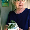 Maxine Campbell stands at her door with a frog music box she got in Alaska. Chris Matula photo.