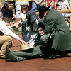 TOWNSPEOPLE TRY TO HELP THE LONGVIEW CITY MARSHALL PLAYED BY CRAIG ELLIOTT OF EDOM TX. DURING THE RENACTMENT OF THE FAMOUS BANK ROBBERY SATURDAY MORNING IN LONVIEW. BY KEVIN GREEN
