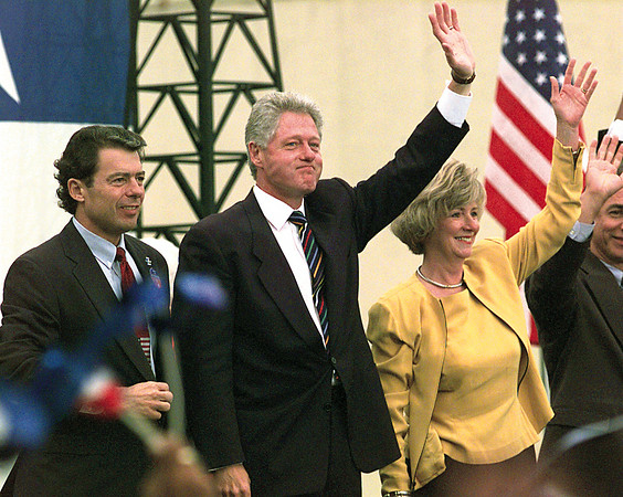 Texas Land Commissioner Garry Mauro, President Clinton and Martha Whitehead wave to the crowd following the President's address.  Lester Phipps, Jr.