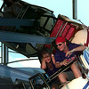 Tiffany Avery, 16, can't stand it anymore as her botfriend Beau Berry, 16, wants more of the Thunderbolt ride at the Gregg County Fair. Chris Matula photo.